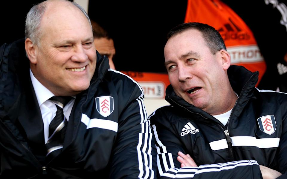 Manager Martin Jol has been sacked by Fulham following defeat at West Ham, which has left the London Premier League club 18th in the table. LONDON, ENGLAND - NOVEMBER 23: (L-R) Martin Jol the Fulham manager chats with Rene Meulensteen the Fulham head coach prior to kickoff during the Barclays Premier League match between Fulham and Swansea City - GETTY IMAGES