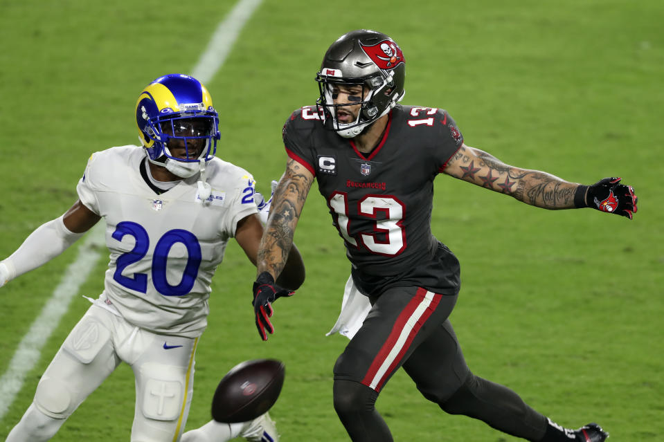 Los Angeles Rams cornerback Jalen Ramsey (20) knocks a pass away from Tampa Bay Buccaneers wide receiver Mike Evans (13) during the first half of an NFL football game Monday, Nov. 23, 2020, in Tampa, Fla. (AP Photo/Mark LoMoglio)