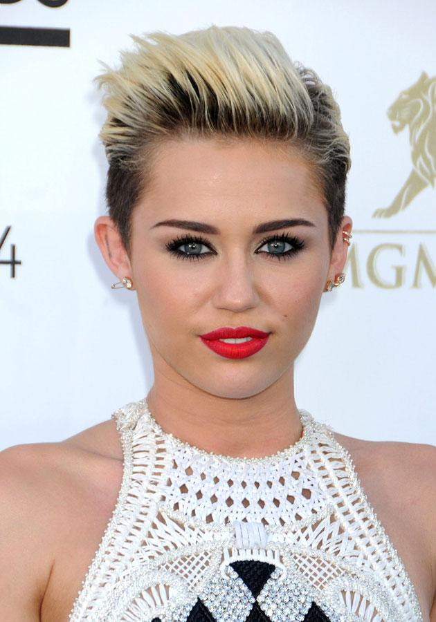 """Celebrities wearing red lipstick: Miley Cyrus wore a pillarblock red pout to the <a href=""""http://uk.lifestyle.yahoo.com/photos/billboard-awards-2013-best-and-worst-dressed-list-slideshow/"""" data-ylk=""""slk:Billboard Awards;outcm:mb_qualified_link;_E:mb_qualified_link;ct:story;"""" class=""""link rapid-noclick-resp yahoo-link"""">Billboard Awards</a>. <br><br>[Rex]"""
