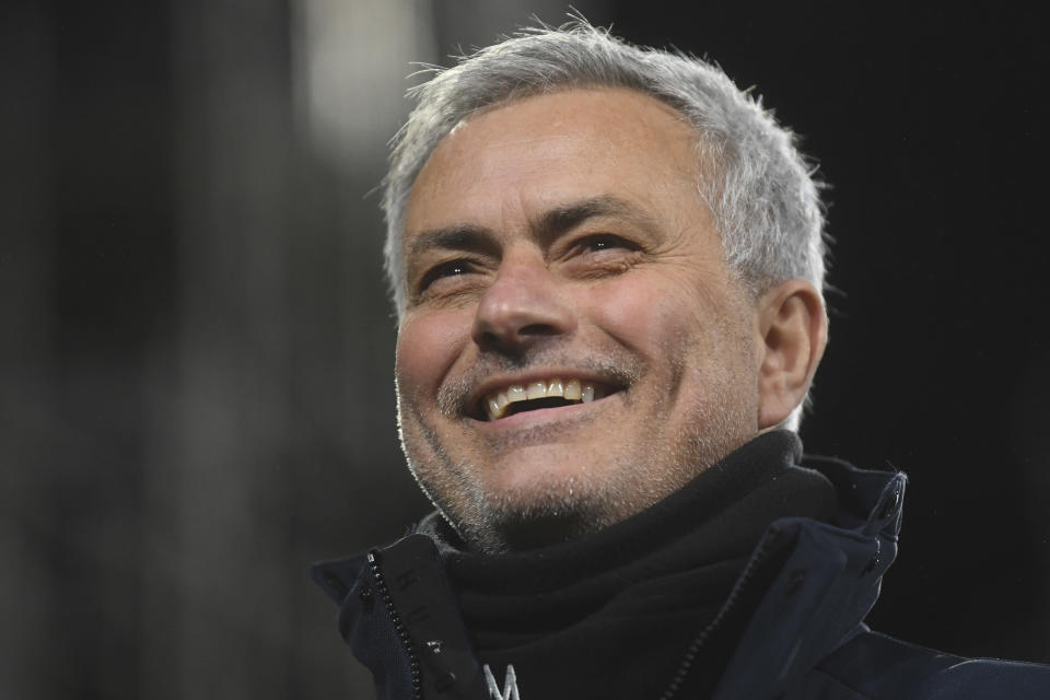 FILE - In this Thursday, March 4, 2021 file photo, Tottenham's manager Jose Mourinho smiles during the English Premier League soccer match between Fulham v Tottenham Hotspur at the Craven Cottage stadium in London. José Mourinho has been hired to coach Italian club Roma starting next season. The move came a few hours after the club's American owners announced that current coach Paulo Fonseca will depart at the end of this season. Mourinho's contract is for three seasons. Mourinho previously coached in Serie A at Inter Milan. (Neil Hall/Pool via AP, File)