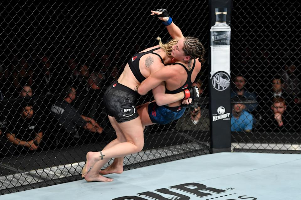 CHICAGO, IL - JUNE 08:  (L-R) Valentina Shevchenko of Kyrgyzstan takes down Jessica Eye in their women's flyweight championship bout during the UFC 238 event at the United Center on June 8, 2019 in Chicago, Illinois. (Photo by Jeff Bottari/Zuffa LLC/Zuffa LLC via Getty Images)