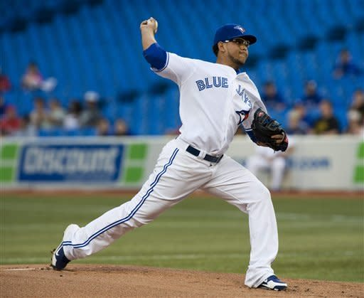 Toronto Blue Jays pitcher Henderson Alvarez Wang delivers against the Washington Nationals during the first inning of an interleague baseball game in Toronto, Tuesday June 12, 2012. (AP Photo/The Canadian Press, Aaron Vincent Elkaim)