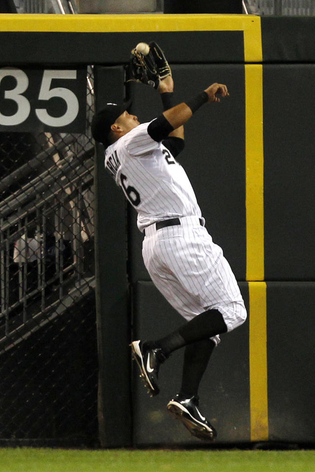 Chicago White Sox right fielder Avisail Garcia catches a fly ball hit by Detroit Tigers' Don Kelly during the first inning of a baseball game Tuesday, Sept. 10, 2013, in Chicago. (AP Photo/Andrew A. Nelles)