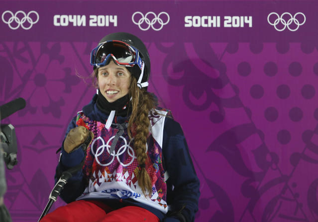 Maddie Bowman of the United States waits for her score after her first run in the women's ski halfpipe final at the Rosa Khutor Extreme Park, at the 2014 Winter Olympics, Thursday, Feb. 20, 2014, in Krasnaya Polyana, Russia. (AP Photo/Sergei Grits)