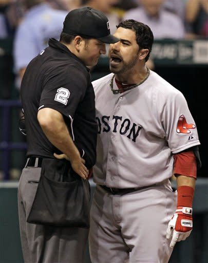 Boston Red Sox's Mike Aviles, right, screams at home plate umpire Dan Bellino after being called out on strikes during the seventh inning of a baseball game against the Tampa Bay Rays, Thursday, May 17, 2012, in St. Petersburg, Fla. (AP Photo/Chris O'Meara)