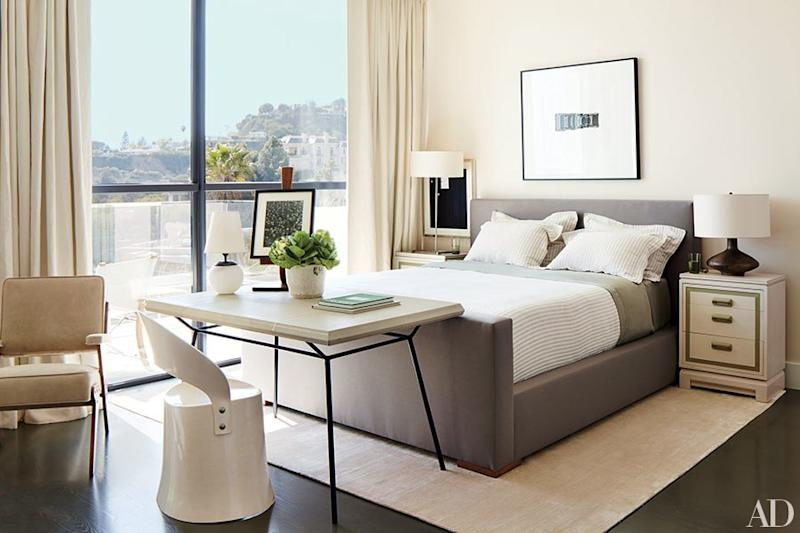 In a Silicon Valley bedroom, interior designer Dan Fink added a touch of life to an otherwise quite neutral room with a potted ornamental cabbage.