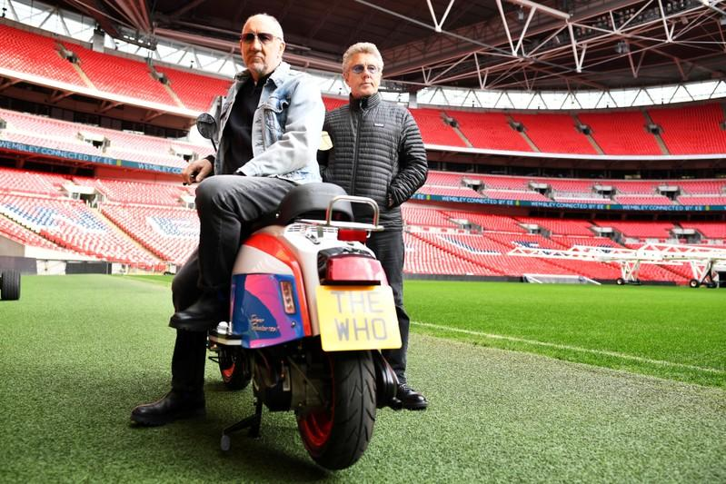 FILE PHOTO: Roger Daltrey and Pete Townshend of British band The Who pose for a picture at Wembley Stadium in London