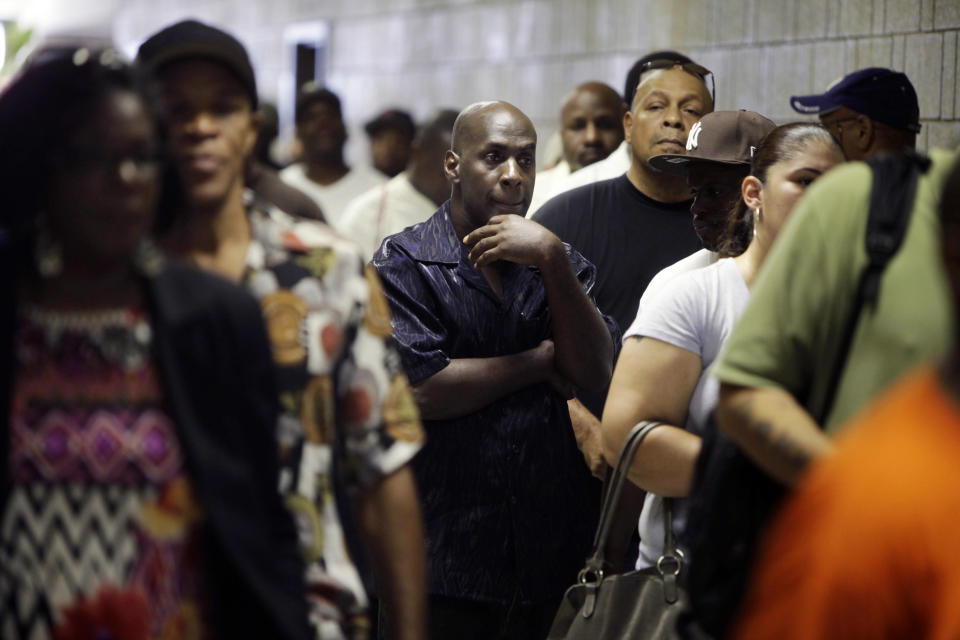 FILE - In this Tuesday, Aug. 21, 2012 file photo, job seekers wait in line at a construction job fair in New York. U.S. employers added 96,000 jobs last month, the Labor Department said Friday, Sept. 7, 2012, a weak figure that could slow any momentum President Barack Obama hoped to gain from his speech to the Democratic National Convention. (AP Photo/Seth Wenig, File)