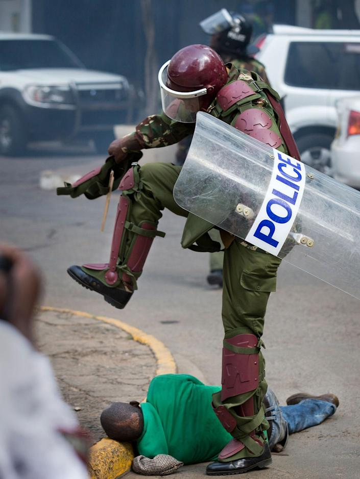 <p>MAY 16, 2016 — A Kenyan riot policeman repeatedly kicks a protester as he lies in the street after tripping over while trying to flee from them, during a protest in downtown Nairobi, Kenya. Kenyan police have tear-gassed and beaten opposition supporters during a protest demanding the disbandment of the electoral authority over alleged bias and corruption. (Ben Curtis/AP) </p>