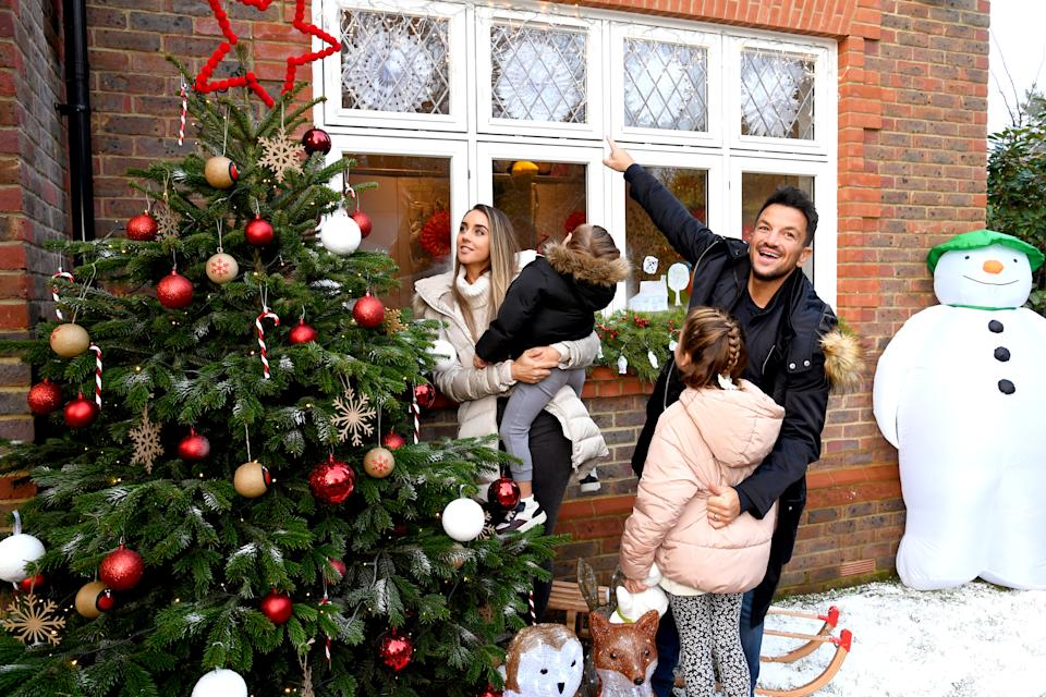 Peter Andre and Emily MacDonagh decorate their Christmas tree and windows as part of the The Snowman Winter Windows Campaign on December 06, 2020 in London, United Kingdom. (Photo by Dave J Hogan/Getty Images)