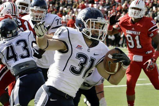 Connecticut wide receiver Nick Williams (31) celebrates as he skips into the end zone untouched to score on a 3-yard run against Louisville during the first half of an NCAA college football game in Louisville, Ky., Saturday, Nov. 24, 2012. (AP Photo/Garry Jones)