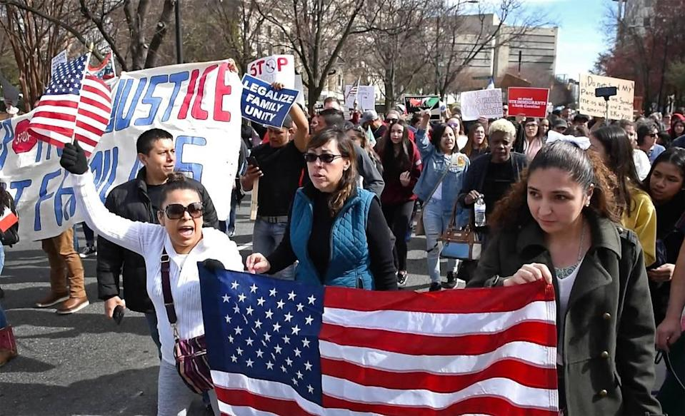 Immigrants and their supporters protest recent arrests conducted by ICE in the Charlotte, N.C., area