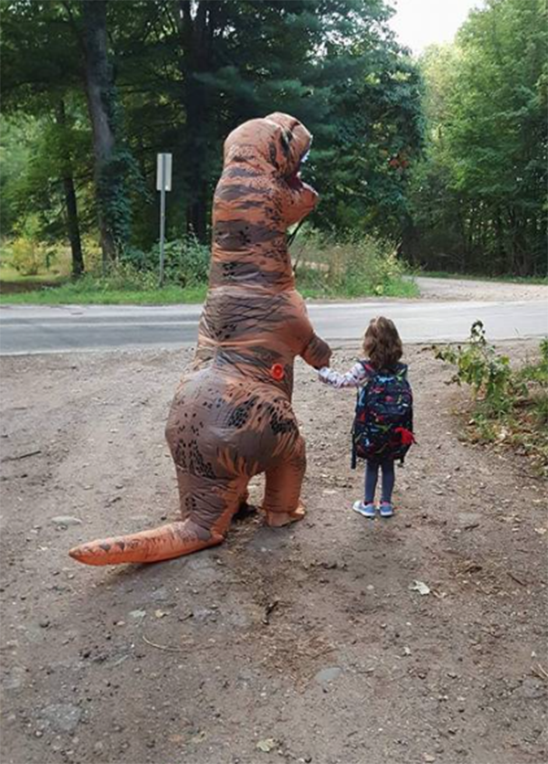 Lori Ferrall sent her daughter to school while dressed as a dinosaur. (Photo: Facebook/Lori Ferrall)