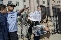 Xu's plight highlights the frustrations, fears and obstacles faced by the families of lawyers and activists who fall foul of the Communist authorities (AFP Photo/NICOLAS ASFOURI)