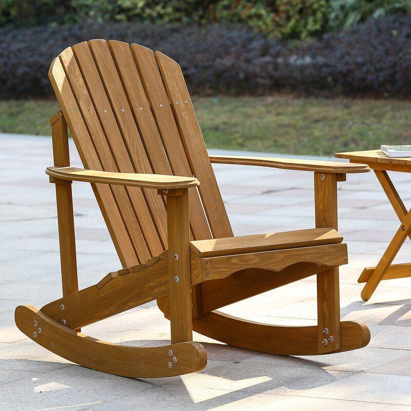 """<p><strong>Highland Dunes</strong></p><p>wayfair.com</p><p><strong>$123.99</strong></p><p><a href=""""https://go.redirectingat.com?id=74968X1596630&url=https%3A%2F%2Fwww.wayfair.com%2Foutdoor%2Fpdp%2Fhighland-dunes-chartier-solid-wood-glider-adirondack-chair-w004925639.html&sref=https%3A%2F%2Fwww.thepioneerwoman.com%2Fhome-lifestyle%2Fdecorating-ideas%2Fg36491091%2Foutdoor-rocking-chairs%2F"""" rel=""""nofollow noopener"""" target=""""_blank"""" data-ylk=""""slk:Shop Now"""" class=""""link rapid-noclick-resp"""">Shop Now</a></p><p>You'll feel like you're at a relaxing mountain lodge retreat with this natural Adirondack rocker. Its solid wood design ensures durability while you spend the summer days relaxing.</p>"""