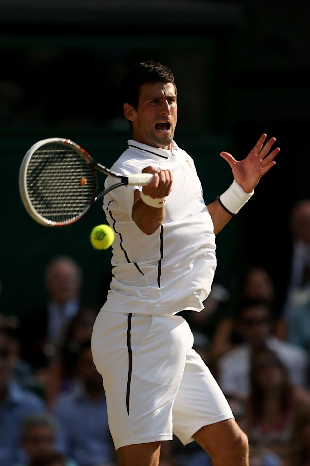 LONDON, ENGLAND - JULY 05: Novak Djokovic of Serbia plays a forehand during the Gentlemen's Singles semi-final match against Juan Martin Del Potro of Argentina on day eleven of the Wimbledon Lawn Tennis Championships at the All England Lawn Tennis and Croquet Club on July 5, 2013 in London, England. (Photo by Clive Brunskill/Getty Images)