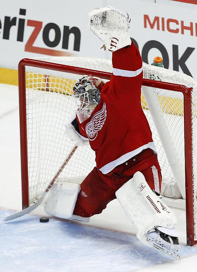 Detroit Red Wings goalie Jonas Gustavsson, of Sweden, stops a Chicago Blackhawks right wing Patrick Kane shot in a shootout during an NHL hockey game Wednesday, Jan. 22, 2014, in Detroit. Detroit won 5-4. (AP Photo/Paul Sancya)