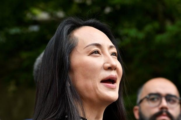Huawei Technologies chief financial officer Meng Wanzhou leaves court in Vancouver after her extradition case was dropped on Friday. (Jennifer Gauthier/Reuters - image credit)