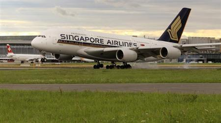 An Airbus A380 jet of Singapore Airlines lands at the airport in Zurich July 14, 2012. REUTERS/Arnd Wiegmann/Files