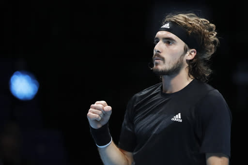 Stefanos Tsitsipas of Greece celebrates after winning a point against Rafael Nadal of Spain during their tennis match at the ATP World Finals tennis tournament at the O2 arena in London, Thursday, Nov. 19, 2020. (AP Photo/Frank Augstein)