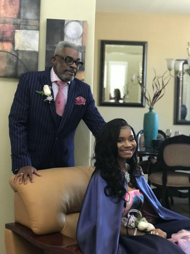 Alvin Hackett, 67, poses with his granddaughter before her senior prom. (Credit: Kaylah Bell)