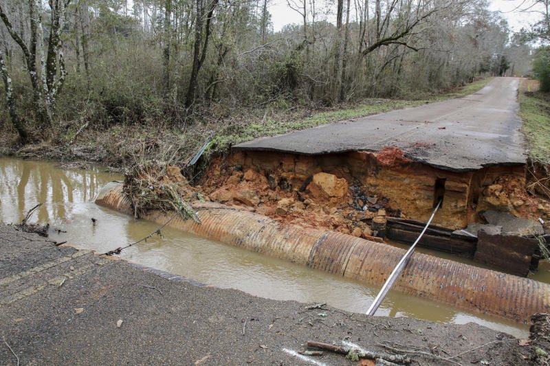 A car fell into this collapsed culvert due to heavy rains on Tommy Butler Road in the Causeyville Whynot area of Lauderdale County, Miss., Friday, Dec 28, 2018. No one was hurt in the accident. The National Weather Service posted flash flood watches and warnings for much of the South from Louisiana into southwest Virginia. (Paula Merritt/The Meridian Star via AP)