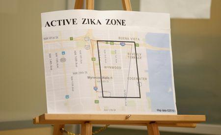 A map showing the active Zika zone is on display at the Borinquen Health Care Center in Miami, Florida, U.S. on August 9, 2016. REUTERS/Chris Keane/File Photo
