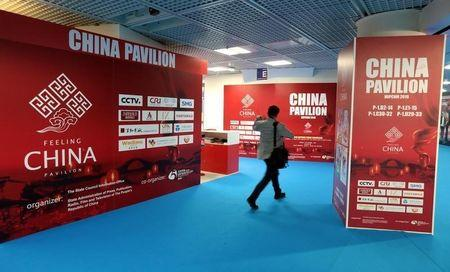 A visitor walks past the China pavillon during the annual MIPCOM television programme market in Cannes, France, October 17, 2016. REUTERS/Eric Gaillard