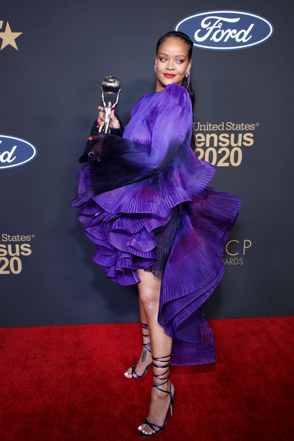 "<p>In a purple ruffled Givenchy dress, strappy sandals, and a 38-carat amethyst diamond ring by <a href=""https://kallati.com/"" rel=""nofollow noopener"" target=""_blank"" data-ylk=""slk:Kallati"" class=""link rapid-noclick-resp"">Kallati</a>, while accepting the <a href=""https://www.harpersbazaar.com/celebrity/latest/a30764700/rihanna-naacp-presidents-award/"" rel=""nofollow noopener"" target=""_blank"" data-ylk=""slk:NAACP President's Award"" class=""link rapid-noclick-resp"">NAACP President's Award</a> at the 51st NAACP Image Awards in Pasadena, California.</p>"