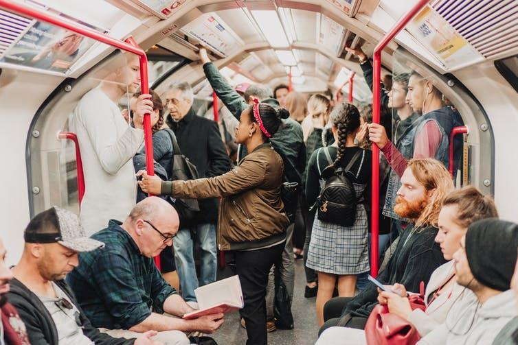 A crowded carriage on the London Underground.