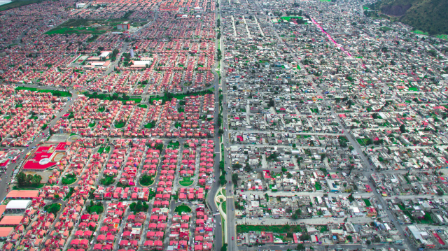 <p>Swathes of colour on the richest side in Mexico City, are a stark contrast to the blandness on the poorest side (MediaDrumWorld/Johnny Miller) </p>
