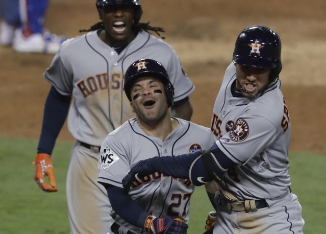 Houston Astros' José Altuve (center) celebrates with George Springer (R) after hitting a two-run home run during Game 2 of the World Series on Oct. 25, 2017. (AP)