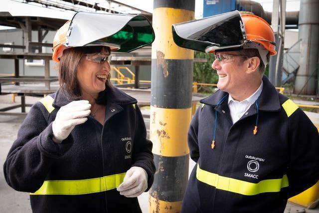 Labour leader Sir Keir Starmer and shadow chancellor Rachel Reeves watch a stainless steel making process during a visit to Outokumpu Stainless Ltd in Sheffield, South Yorkshire