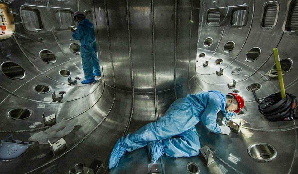 File photo taken on May 27, 2019 shows members of the China National Nuclear Corporation (CNNC) Southwestern Institute of Physics working in the vacuum chamber of China's new-generation 'artificial sun,' in Chengdu, Sichuan Province. Photo: Handout via Xinhua