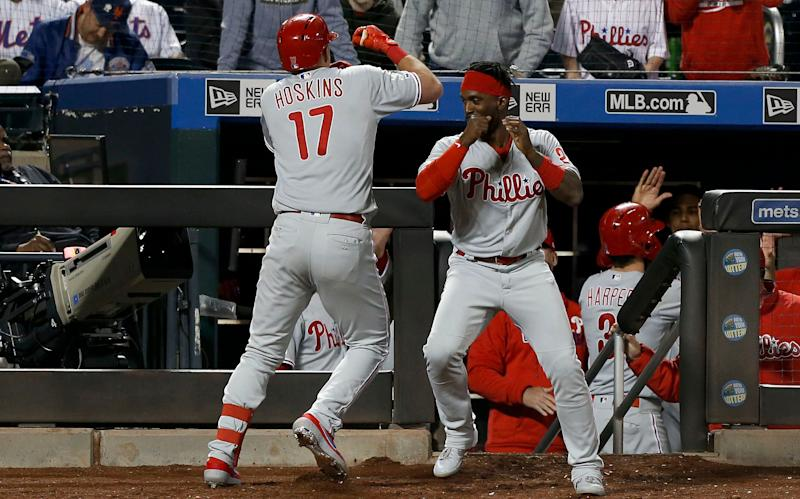 NEW YORK, NEW YORK - APRIL 24: Rhys Hoskins #17 of the Philadelphia Phillies celebrates his ninth inning two run home run against the New York Mets with teammate Andrew McCutchen #22 of the Philadelphia Phillies at Citi Field on April 24, 2019 in New York City. (Photo by Jim McIsaac/Getty Images)