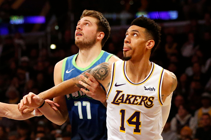 "Dallas Mavericks guard Luka Doncic battles for position with Lakers guard Danny Green during a game in December. <span class=""copyright"">(Katharine Lotze / Getty Images)</span>"