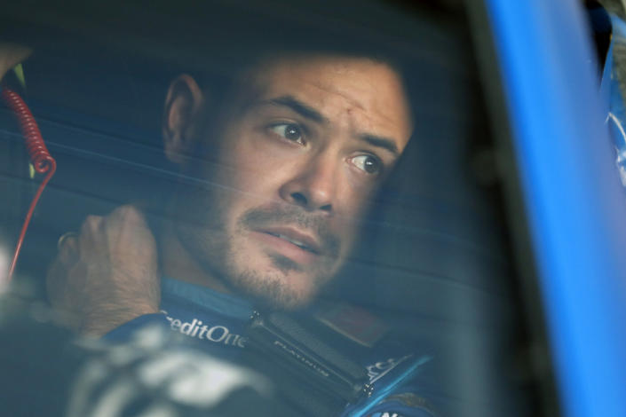 FILE - In this Oct. 18, 2019, file photo, Kyle Larson sits in his car before the final practice for a NASCAR Cup Series auto race at Kansas Speedway in Kansas City, Kan. Kyle Larson was fired by Chip Ganassi Racing, a day after nearly every one of his sponsors dropped the star driver for using a racial slur during a live stream of a virtual race. Of course, in a sport with an extremely checkered racial history, he's already lined up a new gig for 2021 at Hendrick Motorsports. (AP Photo/Colin E. Braley, File)