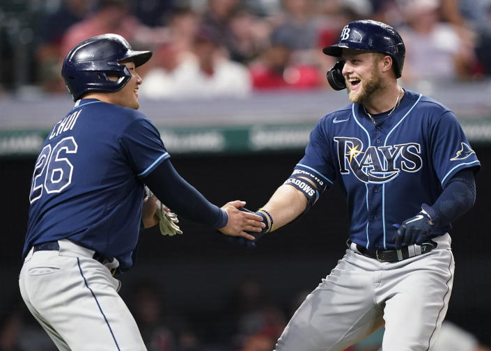 Tampa Bay Rays' Austin Meadows, right, is congratulated by Ji-Man Choi after Meadows hit a two-run home run in the ninth inning of the team's baseball game against the Cleveland Indians, Saturday, July 24, 2021, in Cleveland. (AP Photo/Tony Dejak)