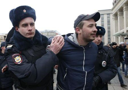Policemen detain a man while patrolling the city centre in the case of an anti-government protest, which was not sanctioned by the authorities, in central Moscow, Russia, April 2, 2017. REUTERS/Maxim Shemetov