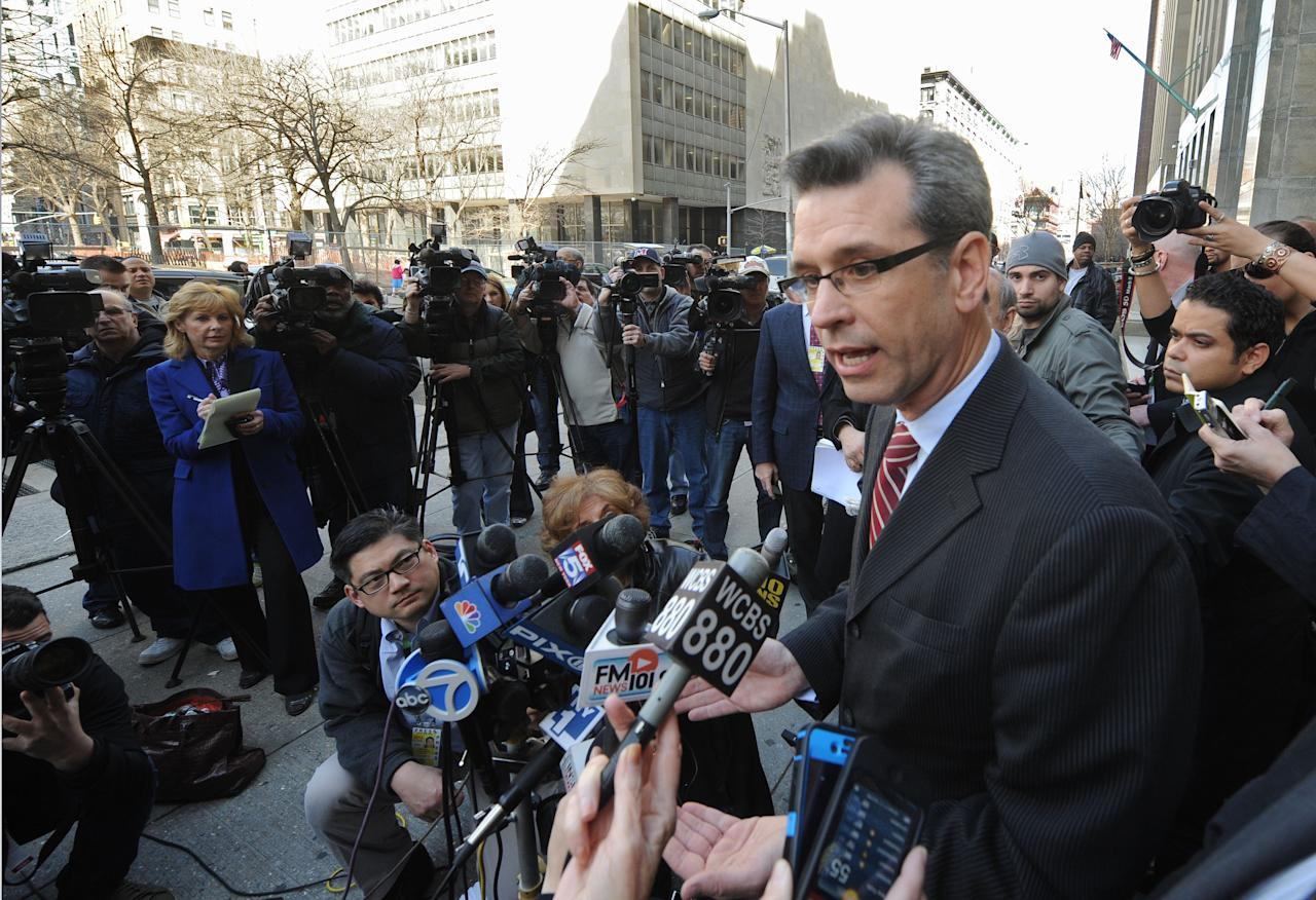 Peter Gleason, left, attorney for Anna Gristina, who has been charged with promoting prostitution, speaks to the media outside State Supreme court following her court appearance, Monday, March 12, 2012, in New York. (AP Photo/Louis Lanzano)