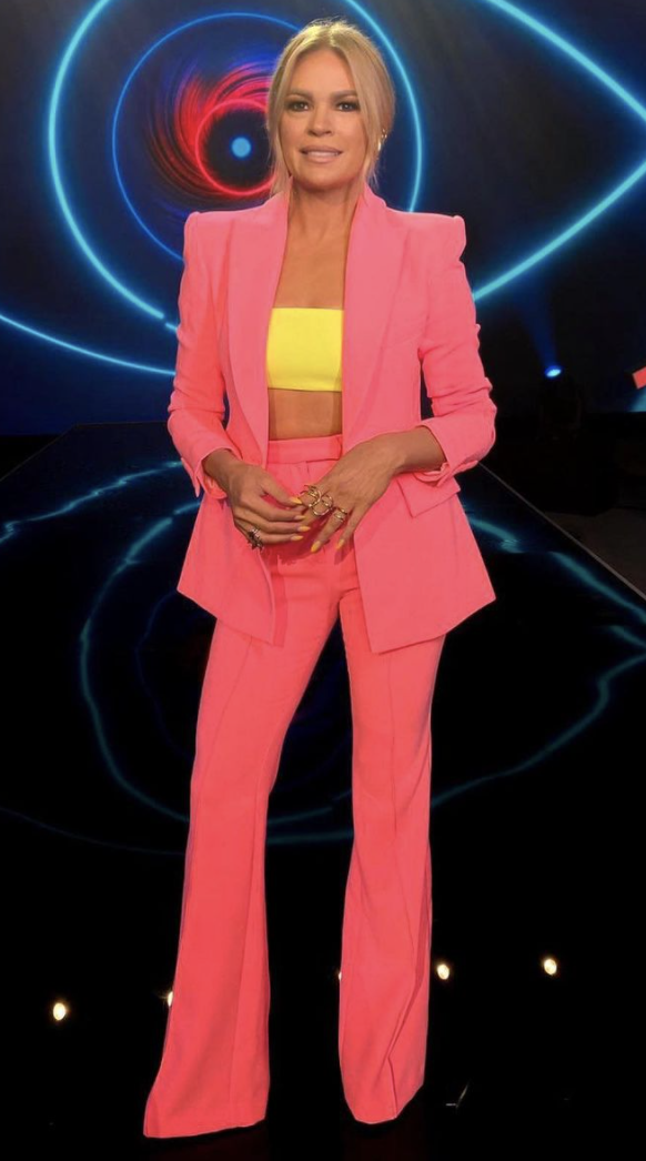Sonia Kruger in pink Alex Perry suit and yellow Versace bandeau top