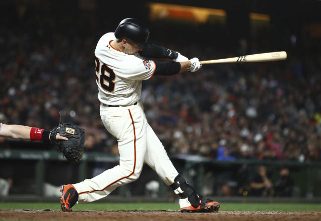 San Francisco Giants' Buster Posey hits an RBI-single off Cincinnati Reds' Dylan Floro in the sixth inning of a baseball game Monday, May 14, 2018, in San Francisco. (AP Photo/Ben Margot)