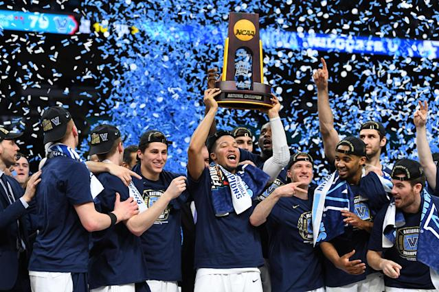 Apr 2, 2018; San Antonio, TX, USA; Villanova Wildcats guard Jalen Brunson (1) hoists the national championship trophy after defeating the Michigan Wolverines 79-62 in the championship game of the 2018 men's Final Four at Alamodome. Mandatory Credit: Robert Deutsch-USA TODAY Sports TPX IMAGES OF THE DAY