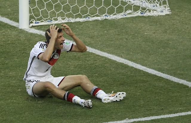 Germany's Thomas Mueller disputes a referee's call during the group G World Cup soccer match between Germany and Ghana at the Arena Castelao in Fortaleza, Brazil, Saturday, June 21, 2014. (AP Photo/Themba Hadebe)