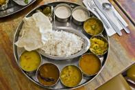 <p><b><br></b></p><p><b>South Indian Meals (Thali)</b></p><p>The traditional Tamil Nadu lunch meal, served on a banana leaf is balanced meal with a mix of many flavours. The main dish in the meal is boiled rice that is accompanied by sambar, rasam, kootu, different types of poriyals, curd, papad, sweet, vada, payasam, and a banana. As you can see, this meal includes ingredients from all food groups and is a healthy choice.</p>