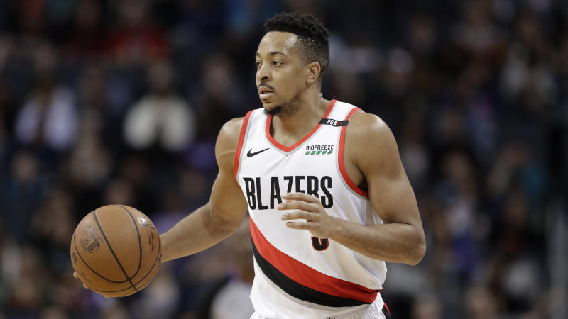 Portland Trail Blazers' CJ McCollum (3) brings the ball up court against the Charlotte Hornets during the first half of an NBA basketball game in Charlotte, N.C., Sunday, March 3, 2019. (AP Photo/Chuck Burton)