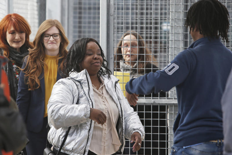 Tondalao Hall, center, greets family members following her release from Mabel Bassett Correctional Center in McLoud, Okla., Friday, Nov. 8, 2019. Hall, who was convicted of failing to report her boyfriend for abusing her children, spent about 13 years longer in prison than he did for the abuse. (AP Photo/Sue Ogrocki)