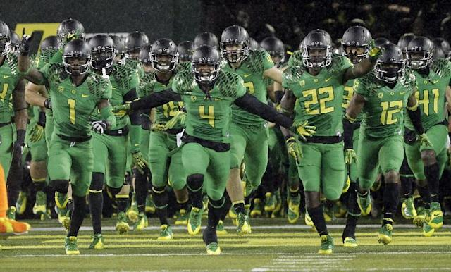The Oregon football team takes the field at Autzen Stadium before an NCAA college football game against California in Eugene, Ore., Saturday, Sept. 28, 2013. Oregon won 55-16. (AP Photo/Don Ryan)