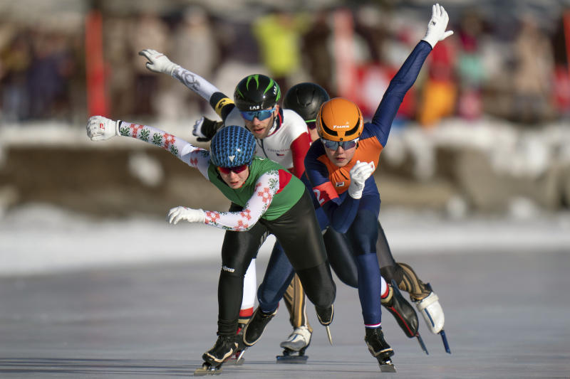 In this photo provided by the IOC, Varvara Bandaryna, of Belarus, front, Myrthe De Boer, of Netherlands, right, and Lukas Stekly, of the Czech Republic, fight for position during heat 5of the Speed Skating Mixed NOC Team Sprint event of the 2020 Winter Youth Olympic Games in St. Moritz, Switzerland, Wednesday, Jan. 15, 2020. (Thomas Lovelock for OIS via AP)