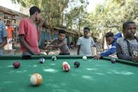 Time for pool: Children try their skills on a Dansha table